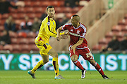 Middlesbrough midfielder Emilio Nsue  turns away from Burnley midfielder David Jones  during the Sky Bet Championship match between Middlesbrough and Burnley at the Riverside Stadium, Middlesbrough, England on 15 December 2015. Photo by Simon Davies.