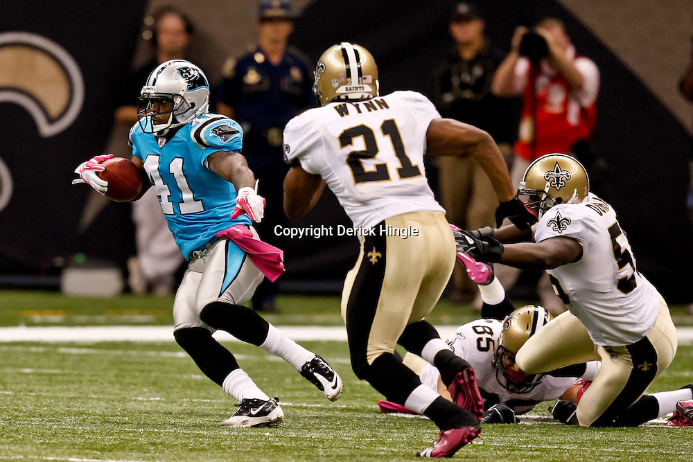 October 3, 2010; New Orleans, LA, USA; Carolina Panthers cornerback Captain Munnerlyn (41) returns a punt against the New Orleans Saints during a game at the Louisiana Superdome. The Saints defeated the Panthers 16-14. Mandatory Credit: Derick E. Hingle