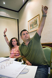 Youth Justice staff members raising their hand to answer a question during training,