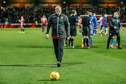 Bolton Wanderers manager Phil Parkinson looks dejected as he comes to collect a ball after the final whistle during the EFL Sky Bet Championship match between Brentford and Bolton Wanderers at Griffin Park, London, England on 22 December 2018.