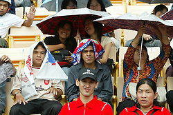 BANGKOK, THAILAND - Wednesday, July 23, 2003: Thai Liverpool fans watch the team training at the Rajamangala National Stadium. (Pic by David Rawcliffe/Propaganda)