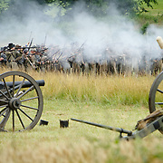 Confederate living historians fire rifles during an artillery and skirmish demonstration, during the Sesquicentennial Anniversary of the Battle of Gettysburg, Pennsylvania on Wednesday, July 3, 2013.  The Battle of Gettysburg lasted from July 1-3, 1863 resulting in over 50,000 soldiers killed, wounded or missing.  John Boal Photography