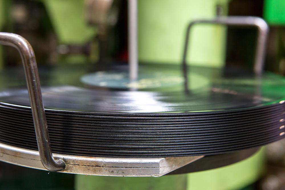 Germany - Deutschland - Optimal Media GmbH - Vinyl Schallplatten Pressung, Fertigung, Produktion; Vinyl Record Pressing - the biggest factory in Germany for record production; HERE:  machine for Vinyl Pressing;       Roebel, 11.12.14; © Christian Jungeblodt