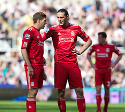 NEWCASTLE-UPON-TYNE, ENGLAND - Sunday, April 1, 2012: Liverpool's Andy Carroll talks with captain Steven Gerrard MBE during the Premiership match against Newcastle United at St James' Park. (Pic by Vegard Grott/Propaganda)