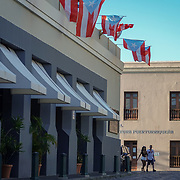 SAN JUAN, PUERTO RICO -- JANUARY 1, 2019: <br /> Tourists and visitors walk on  the Calle del Cristo in Historic Old San Juan. The San Juan Cathedral is down this street. The Governor's mansion or Fortaleza is also found at the end of the road. The Parque de las Palomas is at the end of this street.<br /> (Photo by Angel Valentin)