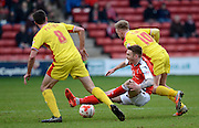 Jordan cook gets fouled during the Sky Bet League 1 match between Walsall and Milton Keynes Dons at the Banks's Stadium, Walsall, England on 14 March 2015. Photo by Alan Franklin.