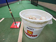 An Angels logo on a bucket of ball in the batting cage under the stadium during the game between the Clinton LumberKings and the Cedar Rapids Kernels at Veterans Memorial Stadium in Cedar Rapids on Monday, September 3, 2012.