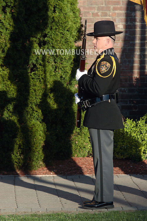 Middletown, N.Y.  - A member of the Orange County Sherrif's Office color guard stands at attention during a  crime victims ceremony at Festival Square on April 29, 2009.