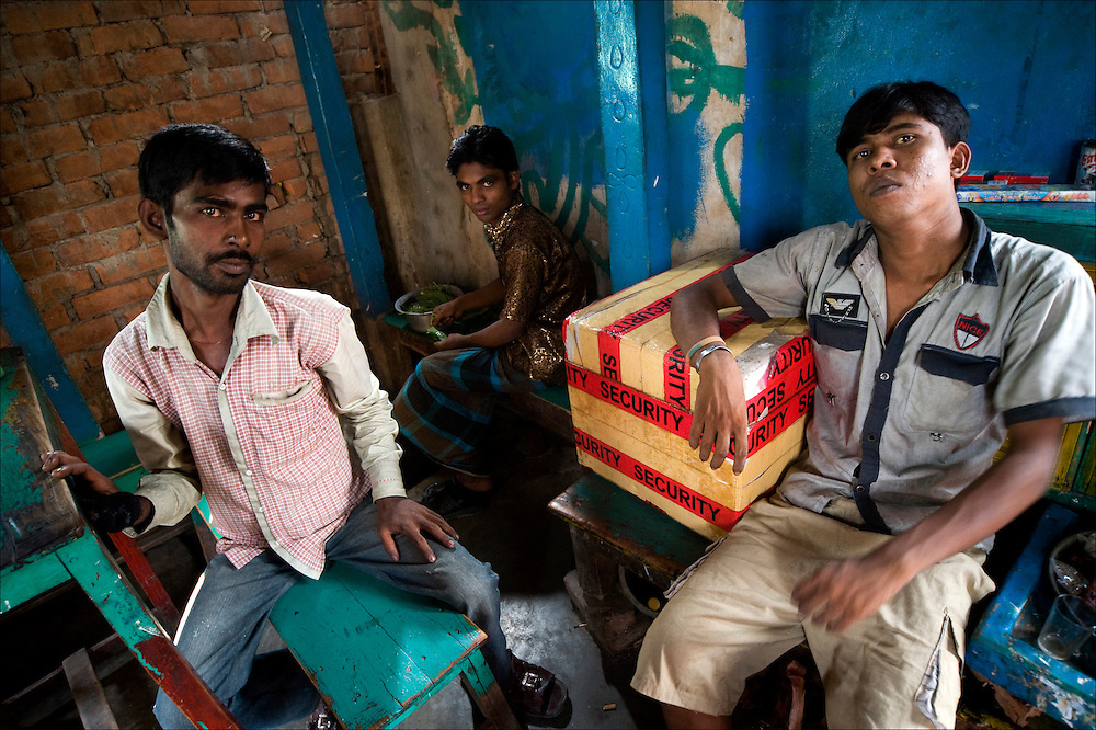 Daulotdia in Bangladesh is one of the biggest brothels in the world – a village of roughly 1,800 women who sell sexual services to about 3,000 men each day..The brothel looks like any other small town in Bangladesh with its fruit stalls, teashops, and workshops. The only difference is the unusual number of women in the street..Opened at the end of the nineteen-century, the 'char' of Daulotdia or river island, is situated at the confluent of two rivers, the Meghna and the Padma. Its location makes it a very important crossing. Thousand of trucks coming from the west and the southwest queue up there for days, waiting to be able to get on a ferry to cross the river and continue towards Dhaka, the capital..It is sometimes three generations of women from the same family who have lived or live in Daulotdia, each of them becoming in turn 'tsukri' (bonded prostitute), 'bharatia' (independent prostitute) and 'bariwalli'/sardani (owner of rooms rented by the prostitutes and owner of prostitutes). The brothel is probably the only place where baby girls are welcomer than baby boys. Once old enough and having become a prostitute, they will be able to look after their mother..Once a woman is identified as a prostitute, it is very difficult for her to be accepted by the Bangladeshi society even if the profession of prostitute has been declared legal and as such can figure on the election cards..How do these girls see their mothers? How do they grow up in the brothel, why do they become themselves prostitute? How do they start, who teach them, how do they become 'bharatia' or 'bariwalli'?.These are the questions we ask ourselves during our visit to Daulotdia..