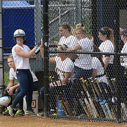 Staff photos by Tom Kelly IV<br /> Neumann's Allie White (5) gets hits a single through the infield during her first at bat against Gwynedd Mercy, making her the all time hit leader for Neumann.  Here, she celebrates wither her teammates after scoring on a delayed steal to home, on a throwing error.