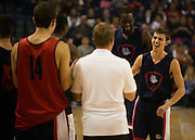 Sam Dower, Jr. and David Stockton laugh with the team after being introduced to the fans during Kraziness in the Kennel. (Photo by Rajah Bose)