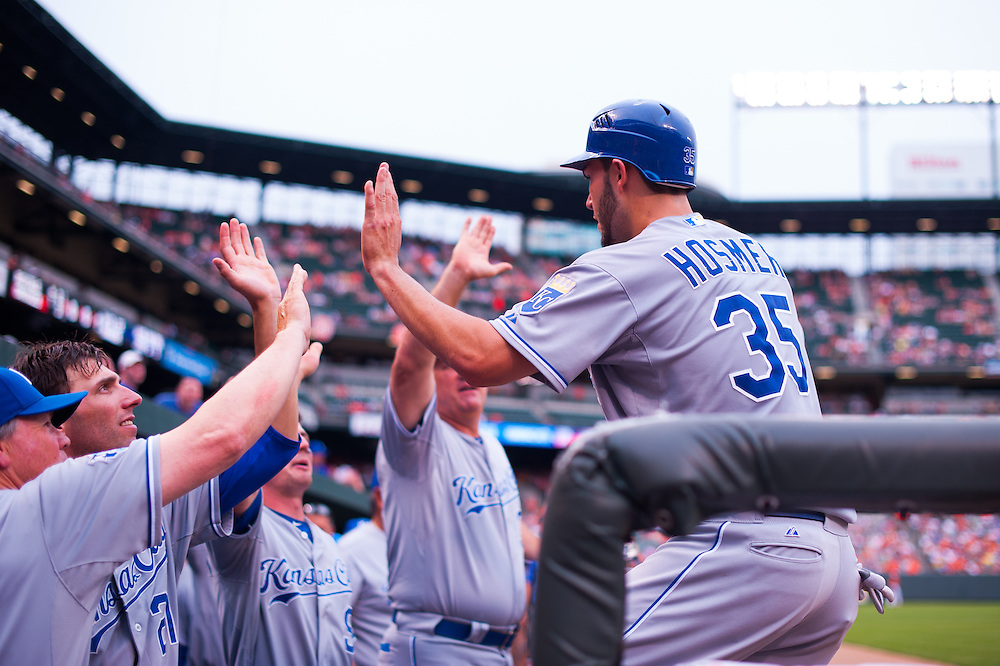 BALTIMORE, MD - MAY 26: Eric Hosmer #35 of the Kansas City Royals hi fives his teammates during the game against the Baltimore Orioles at Oriole Park at Camden Yards on May 26, 2012 in Baltimore, Maryland. (Photo by Rob Tringali) *** Local Caption *** Eric Hosmer