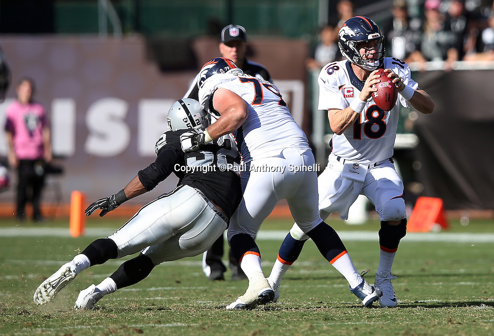 Denver Broncos tackle Michael Schofield (79) blocks Oakland Raiders defensive end Khalil Mack (52) as he chases Denver Broncos quarterback Peyton Manning (18) during the 2015 NFL week 5 regular season football game against the Oakland Raiders on Sunday, Oct. 11, 2015 in Oakland, Calif. The Broncos won the game 16-10. (©Paul Anthony Spinelli)