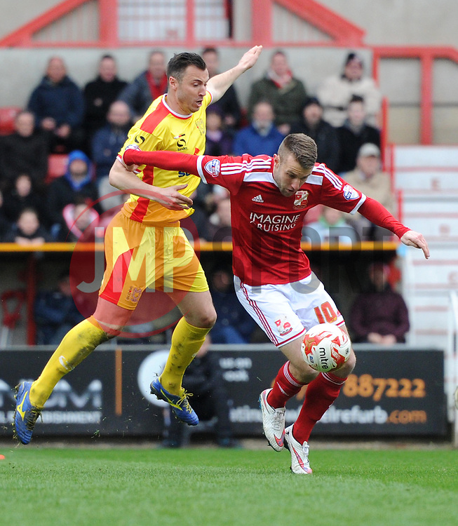 Swindon Town's Andy Williams in action during the Sky Bet League One match between Swindon Town and Milton Keynes Dons at The County Ground on 4 April 2015 in Swindon, England - Photo mandatory by-line: Paul Knight/JMP - Mobile: 07966 386802 - 04/04/2015 - SPORT - Football - Swindon - The County Ground - Swindon Town v Milton Keynes Dons - Sky Bet League One