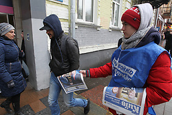 March 27, 2019 - Kiev, Ukraine - A supporter gives out newspapers of Ukrainian presidential candidate Yuri Boyko on a street in Kiev, Ukraine, on 27 March, 2019. The presidential election will held in Ukraine on March 31, 2019. (Credit Image: © Str/NurPhoto via ZUMA Press)