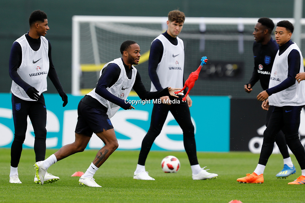 SAINT PETERSBURG, RUSSIA - JULY 10: (L to R) Marcus Rashford, Raheem Sterling, John Stones, Danny Welbeck and Jesse Lingard play with toy rooster during an Englang national team training session ahead of the 2018 FIFA World Cup Russia Semi Final match against Croatia at Stadium Spartak Zelenogorsk on July 10, 2018 in Saint Petersburg, Russia. (MB Media)