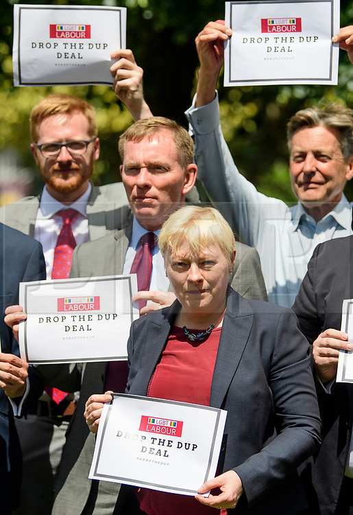 © Licensed to London News Pictures. 13/06/2017. London, UK. Newly elected LGBT MPs and LGBT Labour Lords hold a photocall outside the houses of Parliament in London to protest against the Conservative Party's plans to form an agreement with the DUP of Northern Ireland. Over the weekend British prime minister Theresa May formed a new cabinet and continues discussions with the DUP in an attempt to form a new government. Photo credit: Ben Cawthra/LNP