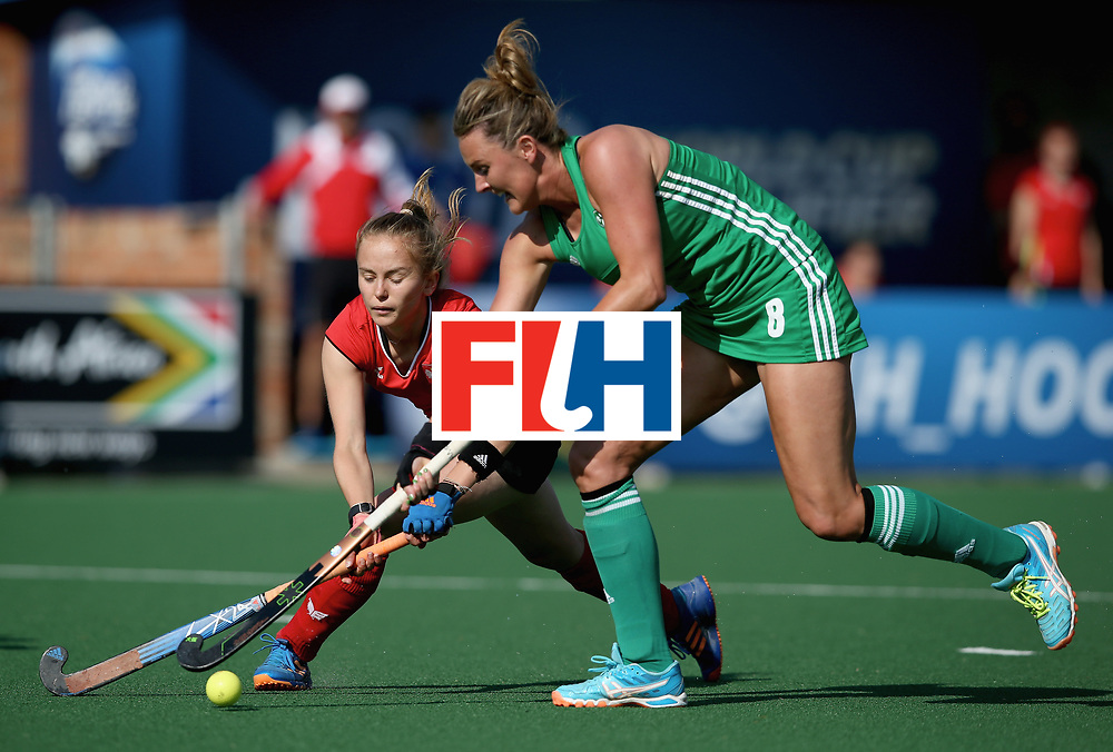 JOHANNESBURG, SOUTH AFRICA - JULY 12: Nicola Evans of Ireland and Monika Polewczak of Poland battle for possession during day 3 of the FIH Hockey World League Semi Finals Pool A match between Ireland and Poland at Wits University on July 12, 2017 in Johannesburg, South Africa. (Photo by Jan Kruger/Getty Images for FIH)