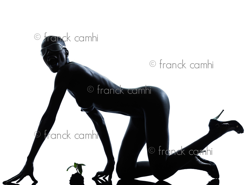 one beautiful black african naked woman protecting nature in studio isolated on white background