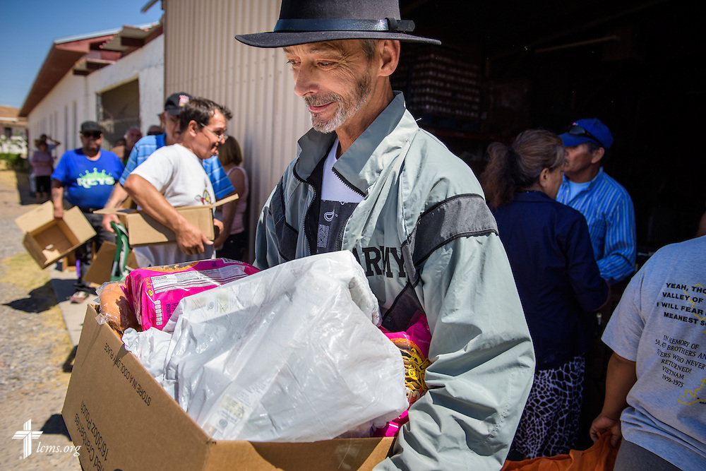 Michael LaBrecque leaves with his box of food during a distribution on Saturday, May 21, 2016, at Ysleta Lutheran Mission Human Care in El Paso, Texas. LCMS Communications/Erik M. Lunsford