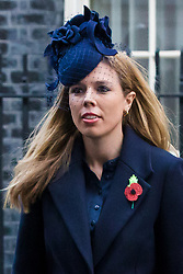 © Licensed to London News Pictures. 10/11/2019. London, UK. Prime Minister, Boris Johnson's girlfriend, Carrie Symonds leaves Downing Street to attend the Remembrance Sunday Ceremony at the Cenotaph in Whitehall. Remembrance Sunday events are held across the country today as the UK remembers and honours those who have sacrificed themselves in two world wars and other conflicts. Photo credit: Vickie Flores/LNP