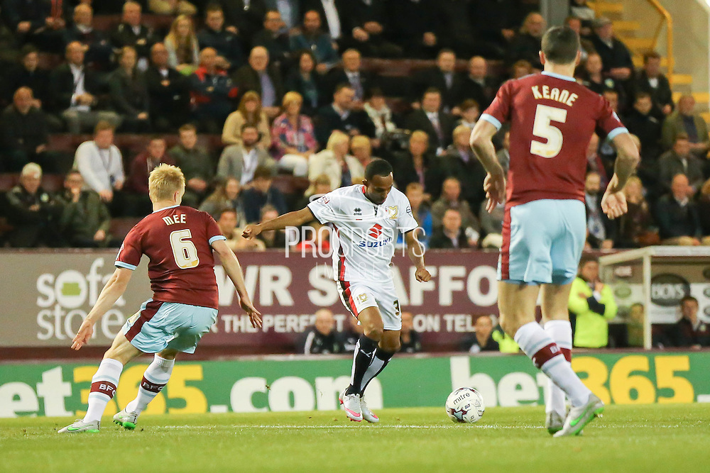 Milton Keynes Dons forward, on loan from Bolton Wanderers, Rob Hall takes on Burnley defender Ben Mee  during the Sky Bet Championship match between Burnley and Milton Keynes Dons at Turf Moor, Burnley, England on 15 September 2015. Photo by Simon Davies.