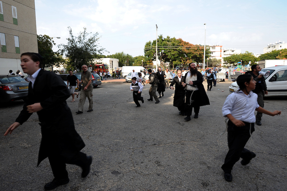Ashdod, Israel - November 17, 2012:Ulltra orthodox Jewish men and chidren are running to sheter as a siren is heard, alerting of a rocket attack from Gaza Strip, at the fourth day of Operation Pillar of Defense. Photo by Gili Yaari  - Israel Photojournalist