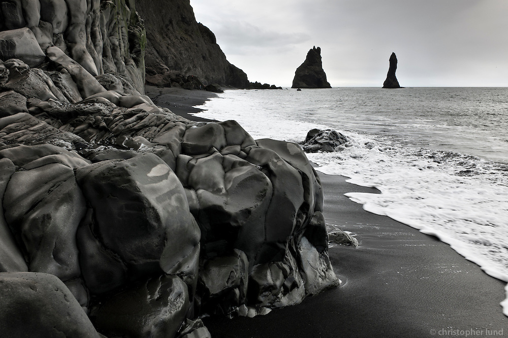Reynisfjara black sand beach, south shore Iceland. Reynisdrangar Sea stacks in background.