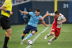 May 31, 2017 - New York City FC midfielder JACK HARRISON (11) just keeps the ball from going out while being chase by New England Revolution midfielder KELYN ROWE (11) at Yankee Stadium in Bronx, NY. (Credit Image: © Mark Smith via ZUMA Wire)