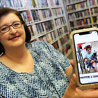 Hamilton and Wren's new librarian Philana Cockerham holds a photo of one of the participants at Wren's recent summer reading program. Cockerham is a lifelong Hamilton resident.