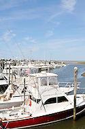 Charter fishing boats docked at Rock Harbor, Orleans, Cape Cod in summer