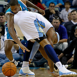 October 29, 2010; New Orleans, LA, USA; New Orleans Hornets small forward Trevor Ariza (1) and Denver Nuggets small forward Carmelo Anthony (15) scramble for a loose ball during the third quarter at the New Orleans Arena.  Mandatory Credit: Derick E. Hingle