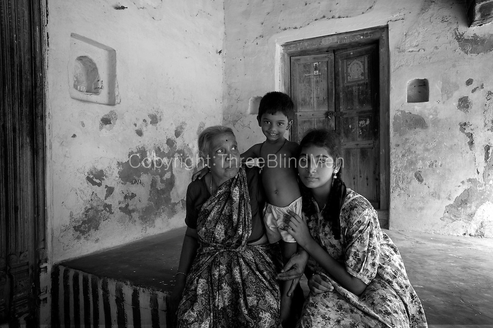 Brahmin family seated on the 'thinnai' of their home in Nagapattinam,South India.