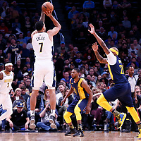 03 April 2018: Denver Nuggets forward Trey Lyles (7) takes a jump shot over Indiana Pacers forward Trevor Booker (20) during the Denver Nuggets 107-104 victory over the Indiana Pacers, at the Pepsi Center, Denver, Colorado, USA.