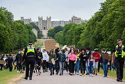 Windsor, UK. 4 June, 2020.  Hundreds of young people take part in a peaceful protest march along the Long Walk in front of Windsor Castle in solidarity with the Black Lives Matter movement. The march was organised at short notice by Jessica Christie at the request of her daughter Yani, aged 12, following the death of George Floyd while in the custody of police officers in Minneapolis in the United States. Credit: Mark Kerrison/Alamy Live News