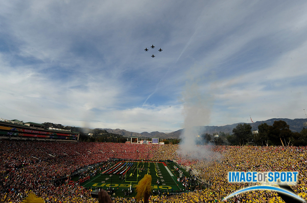 Jan 1, 2010; Pasadena, CA, USA; General view of a Navy hornet flyover during the national anthem before the 2010 Rose Bowl between the Ohio State Buckeyes and Oregon Ducks at the Rose Bowl.