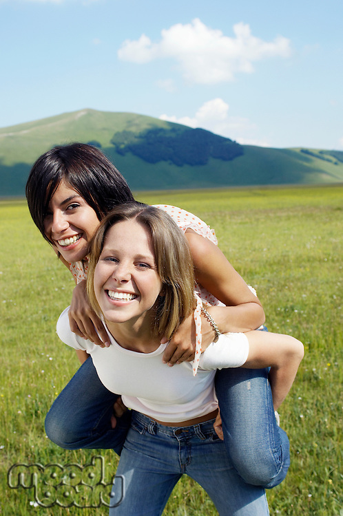 Two Young Women in Meadow
