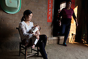YUEYANG, CHINA - MAY 01: (CHINA OUT) <br /> <br /> Mother shows 3-month-old baby boy\'s feet with 16 toes at Zhongping village on May 1, 2016 in Pingjiang County, Yueyang City, Hunan Province of China. Hong Hong was a 3-month-old baby boy who was born with 15 fingers and 16 toes. He had two palms on each hand with 7 fingers on right hand and 8 fingers on left hand. He also had 8 toes on each foot. Hong Hong\'s mother had 6 fingers on each of her hand and 6 toes on each of her foot. Doctor of Hunan Province People\'s Hospital told Hong\'s father that his son had better take an operation since six month old to 1 year old. <br /> ©Exclusivepix media