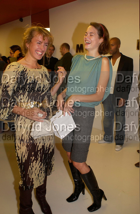 Cynnie Rainey and  Jasmine Guinness, Marni shop opening, Sloane St. 10 September 2003. © Copyright Photograph by Dafydd Jones 66 Stockwell Park Rd. London SW9 0DA Tel 020 7733 0108 www.dafjones.com