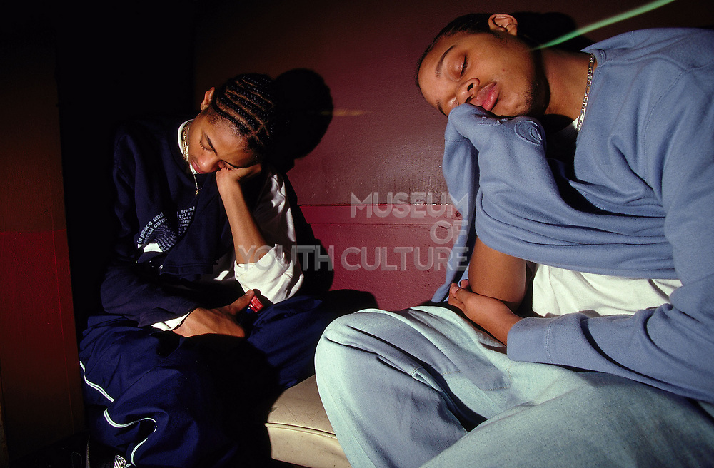 Two tired young clubbers sleeping at Dekefex UK 2001.