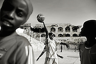 """Suweys during practice - Death or Play. Women´s Basketball in Mogadishu<br /> Women's basketball? In Europa and the U.S., we take it for granted. But consider this: In Mogadishu, war-torn capital of Somalia, young women risk their lives every time they show up to play.<br /> Suweys, the captain of the Somali women´s basketball team, and her friends play the sport of the deadly enemy, called America. This is why they are on the hit list of the killer commandos of Al Shabaab, a militant islamist group, that has recently formed an alliance with the terrorist group Al Qaeda and control large swathes of Somalia.<br /> <br /> Al Shabaab, who sets bombs under market stands, blows up cinemas, and stones women, has declared the female basketball players """"un-islamic"""". One of the proposed punishments is to saw off their right hands and left feet. Or simply: shoot them.<br /> <br /> Suweys´ team trains behind bullet-ridden walls, in the ruins of the failed city of Mogadishu – protected by heavily armed gun-men. The women live in constant fear of the islamist killer commandos. Stop playing basketball? Never, they say.<br /> Women´s basketball in the world´s most dangerous capital. Female basketball in Mogadishu, Somalia.<br /> A deadly game.."""