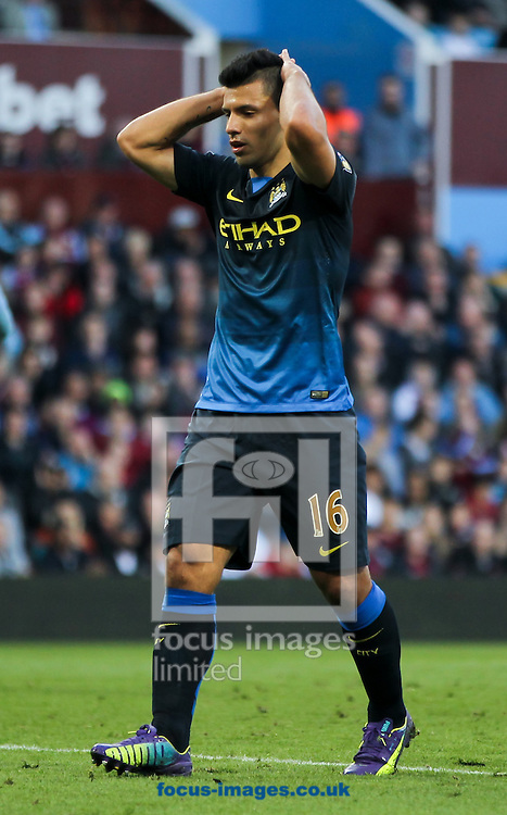 Sergio Ag&uuml;ero of Manchester City reacts to coming close to scoring during the Barclays Premier League match at Villa Park, Birmingham<br /> Picture by Tom Smith/Focus Images Ltd 07545141164<br /> 04/10/2014