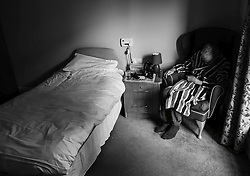 © Licensed to London News Pictures. 09/04/2014<br /> These photographs have been converted to black and white<br /> <br /> Durham, United Kingdom<br /> <br /> Parkinson's Disease sufferer David Forsyth from Brandon, County Durham falls asleep in a chair during a respite stay in a care home.<br /> <br /> These visits to a care home are becoming more frequent as the demands on him and his wife who provides full time care to him begins to take a toll.<br /> <br /> Parkinson's is a long-term neurological condition that affects the way the brain co-ordinates body movements including walking, talking and writing and affects both men and women.<br /> <br /> Photo credit : Ian Forsyth/LNP