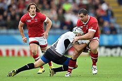 Aaron Carpenter of Canada is tackled in possession - Mandatory byline: Patrick Khachfe/JMP - 07966 386802 - 06/10/2015 - RUGBY UNION - Leicester City Stadium - Leicester, England - Canada v Romania - Rugby World Cup 2015 Pool D.