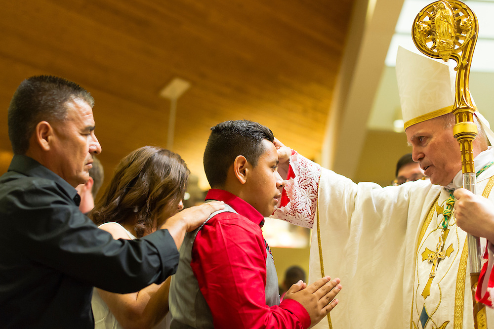 AURORA, CO - JUNE 4: Rite of Confirmation at Queen of Peace Catholic Church on June 4, 2014, in Aurora, Colorado. (Photo by Daniel Petty/Denver Catholic Register)