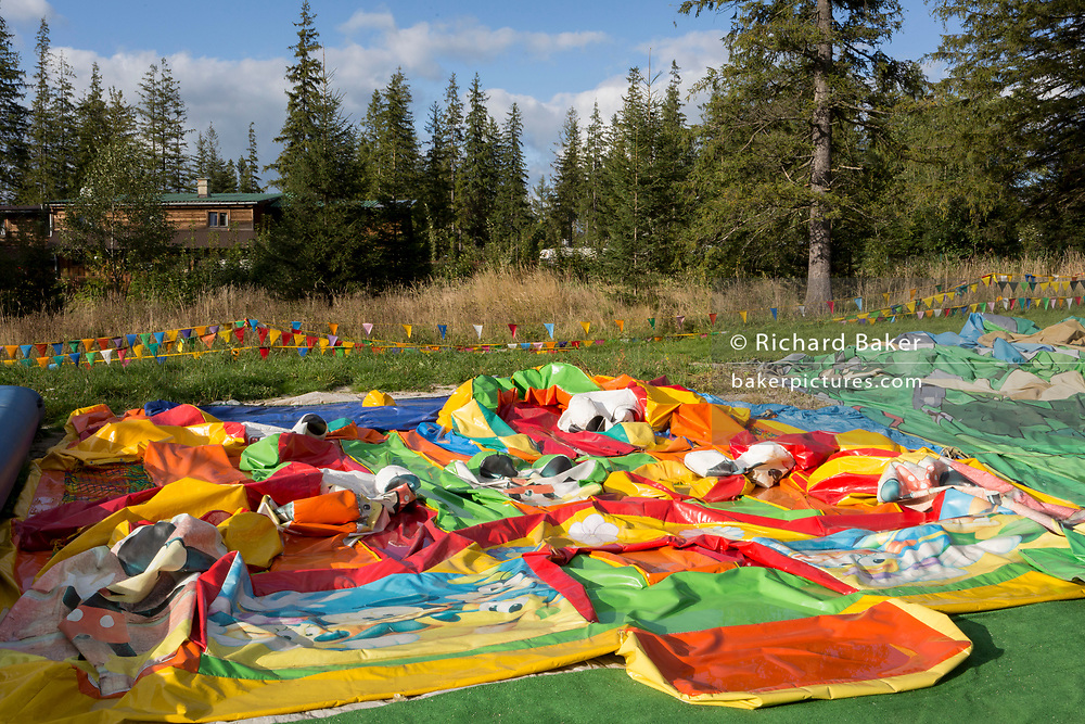 A landscape of a Polish version of Disneyland that features a deflated childrens' inflatable bouncy castle, on 18th September 2019, near the Wielka Krokiew ski jump, Zakopane, Malopolska, Poland.