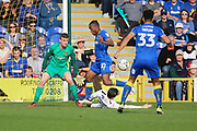 Northampton Town defender Zander Diamond (5) tackling AFC Wimbledon striker Dominic Poleon (10) during the EFL Sky Bet League 1 match between AFC Wimbledon and Northampton Town at the Cherry Red Records Stadium, Kingston, England on 11 March 2017. Photo by Matthew Redman.