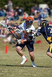 Virginia Cavaliers M Nick Elsmo (2) is checked by Drexel Dragson M Chris Farquhar (27).  The #2 ranked Virginia Cavaliers defeated the Drexel Dragons 13-7 at the University of Virginia's Klockner Stadium in Charlottesville, VA on February 14, 2009.
