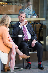 Nigel Farage arrives to The Andrew Marr Show. UKIP leader Nigel Farage drinks coffee before going to the BBC broasting house Sunday morning. He is one of the guests on BBC political show. Also appearing are former Lib Dem leader Lord Ashdown, Wikipedia co-founder Jimmy Wales, and Monty Python