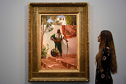 "© Licensed to London News Pictures. 21/04/2017. London, UK.  A staff member views ""The Sentinel"" by Jean-Joseph Benjamin Constant, (est. GBP 120-150k), at a preview at Sotheby's, New Bond Street, of upcoming sales of Arts of the Islamic World, 20th century Middle East Art and Orientalist art. Photo credit : Stephen Chung/LNP"